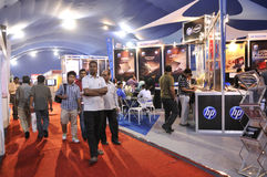 ICT  Fair in Kolkata. KOLKATA- FEBRUARY 20: People passing by a HP Pavilion during the Information and Communication Technology (ICT) conference and exhibition Royalty Free Stock Image