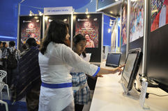 ICT  Fair in Kolkata. KOLKATA- FEBRUARY 20: A sales associate explaining a customer during the Information and Communication Technology (ICT) conference and Royalty Free Stock Photography