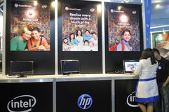 ICT  Fair in Kolkata. KOLKATA- FEBRUARY 20:A sales associate explaining customers about HP products during the Information and Communication Technology (ICT) Stock Image