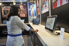 ICT  Fair in Kolkata. KOLKATA- FEBRUARY 20: A sales associate playing around with an HP DreamScreen ,during the Information and Communication Technology (ICT) Stock Photography