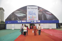 ICT  Fair in Kolkata. KOLKATA- FEBRUARY 20: Visitors coming out of the auto industry booth during the Information and Communication Technology (ICT) conference Royalty Free Stock Photo