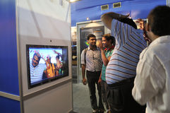 ICT  Fair in Kolkata. KOLKATA- FEBRUARY 20: Visitors watching themselves in a bubble screen,during the Information and Communication Technology (ICT) conference Stock Photos