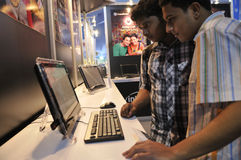 ICT  Fair in Kolkata. KOLKATA- FEBRUARY 20: Young teens looking at the HP DreamScreen, during the Information and Communication Technology (ICT) conference and Stock Image