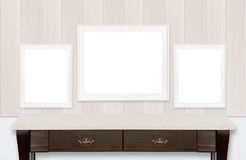 Icture frames on wood wall and white background. Three picture frames on wood wall and white background Royalty Free Stock Photo