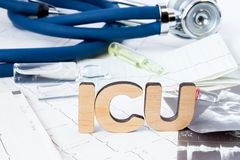 ICU Abbreviation or acronym of intensive care unit in hospital or clinic, special medical unit. Word ICU is on ECG stripes in fore. Ground near results of royalty free stock photos