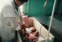 ICU Babies in a Box. A nurse tend to premature infants in northern Vietnam Stock Photos
