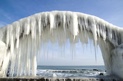 Icy arches from storm in winter on seashore, Bulgaria Stock Images