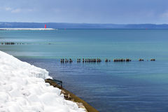Icy Baltic sea coast at winter. Stock Photos