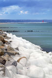 Icy Baltic sea coast at winter time. Royalty Free Stock Images