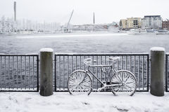 Icy bicycle next to river Royalty Free Stock Images