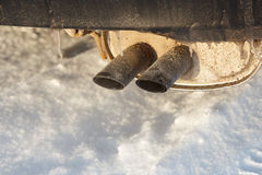 Icy car exhaust Stock Image