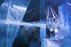 Icy Chandelier. Chandelier with glass beads between ice blocks at an ice bar Royalty Free Stock Photo