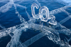 Icy chemical formula of carbon dioxide CO2. Chemical formula of greenhouse gas carbon dioxide CO2 made from ice on winter frozen lake Baikal Royalty Free Stock Photo