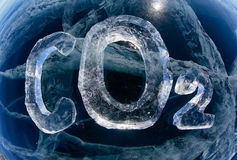 Icy chemical formula of carbon dioxide CO2. Chemical formula of greenhouse gas carbon dioxide CO2 made from ice on winter frozen lake Baikal Stock Photo