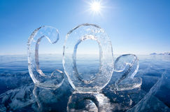 Icy chemical formula of carbon dioxide CO2. Chemical formula of greenhouse gas carbon dioxide CO2 made from ice on winter frozen lake Baikal under blue sky and Stock Images