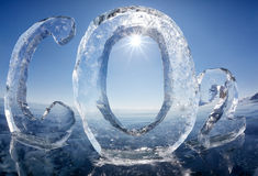Icy chemical formula of carbon dioxide CO2. Chemical formula of greenhouse gas carbon dioxide CO2 made from ice on winter frozen lake Baikal under blue sky and Stock Image