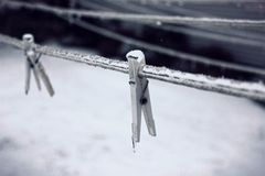 Icy Clothes Pins Stock Images