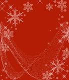 Icy Cold Snowflakes. Beautiful crystal snowflakes and swirls on an icy red background Stock Photo
