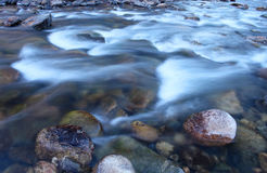 Icy cold water flows down the Poudre River on a chilly morning Stock Photos
