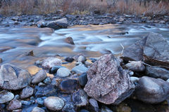 Icy cold water flows down the Poudre River on a chilly morning Royalty Free Stock Images