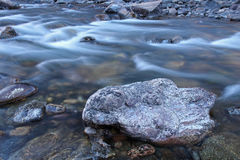 Icy cold water flows down the Poudre River on a chilly morning Royalty Free Stock Photo