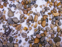 Icy colored stones background Royalty Free Stock Photography