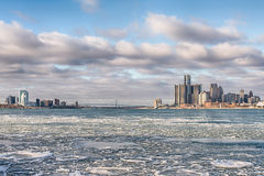 Icy Detroit River, Detroit and Windsor, Ontario skylines, Ambassador Bridge. DETROIT, MI/USA - JANUARY 29, 2016: Icy Detroit River, Detroit and Windsor, Ontario Stock Photos