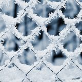 Icy fence. Beautiful winter seasonal abstract background. Stock Images