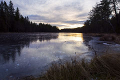 Icy fresh water lake in the sunset Stock Photography