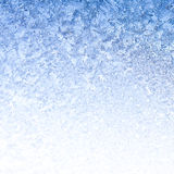Icy Frost on winter morning. Frosty winter background photo of ice buildup on a window Stock Photography