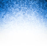 Icy Frost on winter morning. Frosty winter background photo of ice buildup on a window Royalty Free Stock Photography