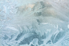 Icy frozen pattern on glass Stock Photos