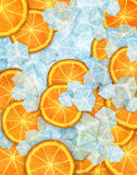 Icy fruit. Juicy citrus fruit mixed with cold blue ice cubes Royalty Free Stock Photo