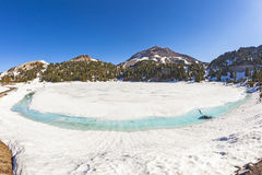Icy glacier lake on foot of Mount Lassen Royalty Free Stock Image