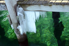 Icy green harbor water on Seneca Lake. Showing the Seneca Lake dock after winter storm Stella. One of the Finger Lakes of New York State. At 38 miles long and stock images