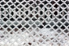 Icy Grid. Winter frost on the grid stock images