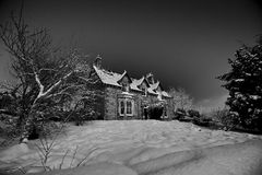 Icy grip. Old stone house covered under heavy snow fall (Scotland&#x29 Royalty Free Stock Image