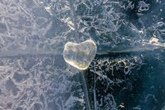 Icy heart in a crack in the light of sunset. lake Baikal Stock Image