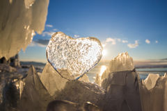 Icy heart in the hummock in the light of sunset. lake Baikal Royalty Free Stock Photos