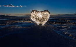 Icy heart in the waves in the light of sunset. lake Baikal Stock Photography