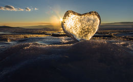 Icy heart in the waves in the light of sunset. lake Baikal Royalty Free Stock Photos