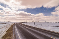 Icy Highway with cloudy skies. Royalty Free Stock Photography
