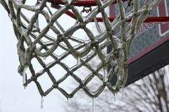 Icy Hoop 2. Closer view of an ice covered basketball hoop in Burlington, Vermont. You can see icicles have formed on the net Royalty Free Stock Image