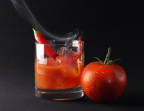 Icy hot tomato drink. An icy hot cocktail with tomato juice, vodka and chili pepper royalty free stock image