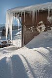 Icy House in the Alps. A house covered in ice and snow in the Swiss Alps stock image