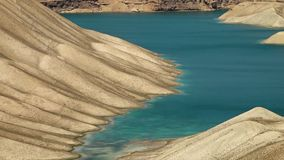 Icy lake water frozen on desert sand valley. The shallow edge of the lake meets the desert sand. Band-e Amir Lakes. Band-e Amir National Park, Bamyan Province stock video