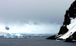Icy landscape in Antarctica. A large glacier and iceberg in Antarctica Stock Image