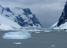 Icy landscape in Antarctica. A large glacier and icebergs in Antarctica royalty free stock photos