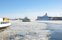 Icy landscape with a sailing ship in Helsinki Royalty Free Stock Photography