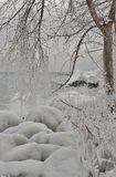 Icy layers on lake shore Stock Images